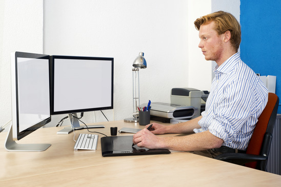Keeping good posture to prevent back pain
