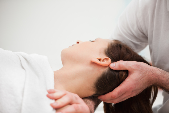 Chiropractor adjust the neck