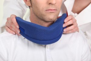 Chiropractor is treating patient with Whiplash