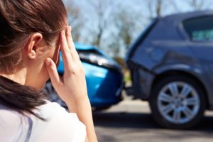 Woman with accident injury caused by car crash
